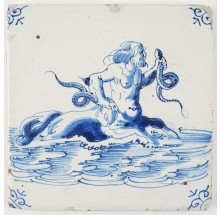 Antique Delft tile in blue depicting Triton holding two snakes, 17th century Harlingen