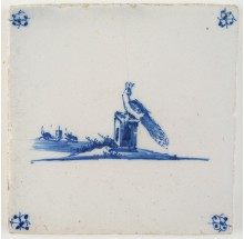 Antique Delft tile in blue with a peacock in a landscape, 18th century