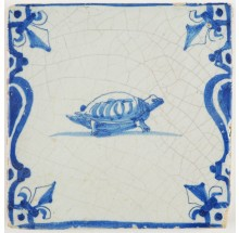 Antique Delft tile in blue with a turtle depicted between balusters and lily corner motifs, 17th century