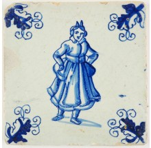 Antique Delft tile in blue with a lady posing or dancing, 17th century