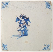 Antique Delft tile in blue depicting Cupid playing the violin, 17th century