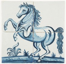 Antique Delft tile mural with a prancing horse in blue facing left, 19th century