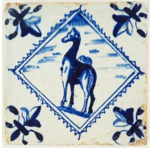 Antique Delft tile in blue with a camel in a diamond square, 17th century