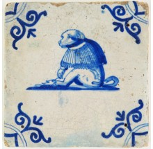 Antique Delft miniature sized tile in blue with a dressed monkey, 17th century