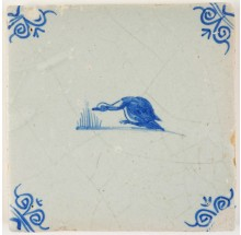 Antique Delft tile in blue with a goofy looking goose, 17th century