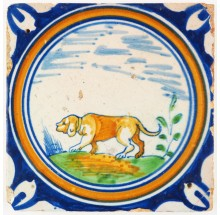 Antique Delft tile with a polychrome hunting dog in a circle, early 17th century