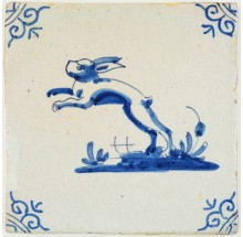 Antique Delft tile with a jumping hare in blue, 17th century