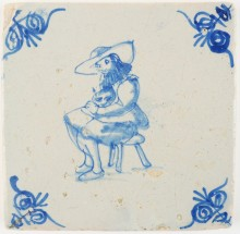 Antique Delft tile with a lady sitting in a chair with a cat on her lap, 17th century