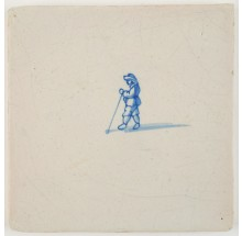 Antique Delft tile with a golf player in blue, 17th century