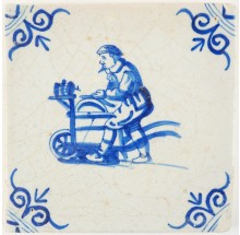 Antique Delft tile with a man sharpening knifes, 17th century