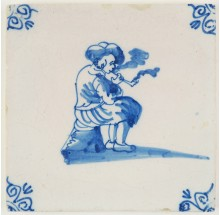 Antique Delft tile with a man smoking a tobacco pipe, 18th century