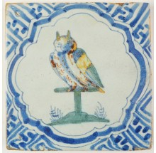 Antique Delft tile with a polychrome tame owl in a 'Wanli' inspired border motif, 17th century