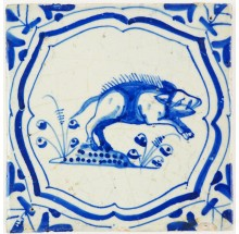 Antique Delft tile in blue with a swine on the run, 17th century