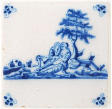 Antique Delft tile with an erotic scene between a man and a woman in a typical Dutch landscape, 18th century