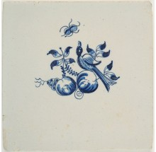 Antique Delft tile with a bird between fruits, Harlingen 18th century