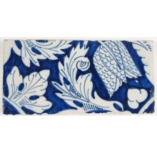 Antique Delft border tile in blue with an ornament flower design, 18th century