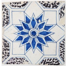 Antique Delft tile with a star ornament in blue and manganese, 17th century