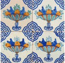 Antique Delft wall tiles with beautiful polychrome fruits bowls decorated with Wanli inspired corner motifs, 17th century