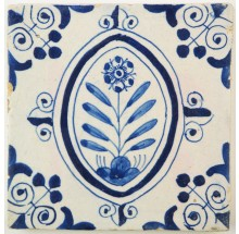 Antique Delft tile in blue with a flower in an oval border, first half 17th century