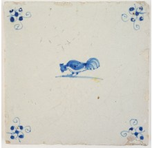 Antique Delft tile with a rooster picking seeds, 17th century