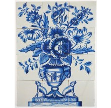 Antique Delft tile mural in blue with a richly decorated flower vase and two dogs at guard on the sides, 18th century