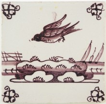 Antique Delft tile in manganese with a bird in flight, late 18th century