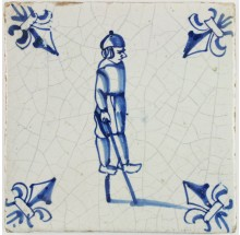 Antique Dutch Delft tile with a boy walking on stilts, 17th century