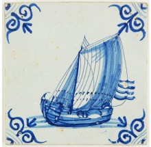 Antique Dutch Delft tile in blue with a wonderful cargo boat under sail, 17th century