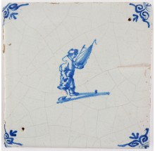 Antique Delft tile depicting a child with a miniature sailing boat, 17th century