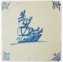 Antique Delft tile with a child on a sledge, 17th century