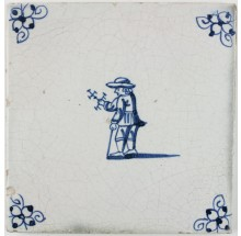 Antique Delft tile in blue with a child playing with a miniature windmill, 18th century