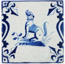 Antique Dutch Delft tile with in blue with a dog barking, 17th century