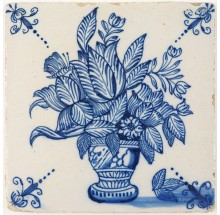 Antique Delft tile with an extremely well painted flower vase in blue, 18th century