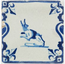 Antique Dutch Delft tile with a beautiful jumping hare in a baluster border, early 17th century