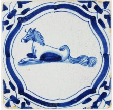 Antique Delft tile in blue with a horse lying, 17th century