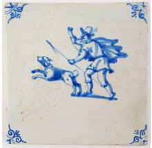 Antique Delft tile in blue depicting a hunter and his dog, 17th century