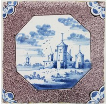 Antique Delft tile with a Dutch landscape in blue with a manganese border, 18th century