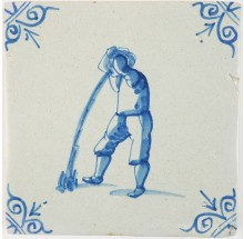 Antique Delft tile in blue with a man puking, 17th century