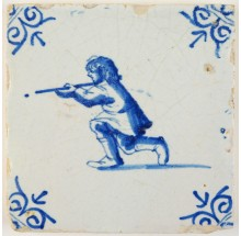 Antique Delft tile with a young man shooting a rifle, 17th century