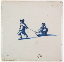 Antique Dutch Delft tile with two children in and towing a sledge, 17th century
