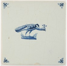 Antique Delft tile with a peacock in blue, 17th century