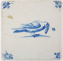 Antique Delft tile in blue with a pigeon with a twig in its beak, 17th century