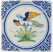 Antique Delft tile with a beautiful polychrome bird in flight, 17th century