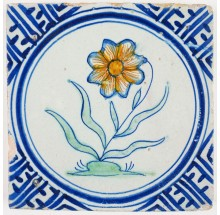 Antique Delft tile with a beautiful flower and a Wanli inspired corner motif, 17th century