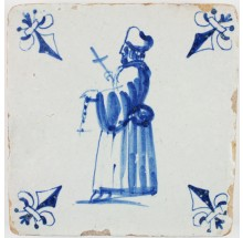 Antique Dutch Delft tile in blue with a priest holding a cross, 17th century