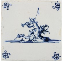 Antique Dutch Delft tile depicting a shepherd blowing a horn, 17th century