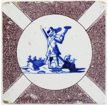 Antique Delft tile with a shepherd in blue decorated with a dizzled circle in manganese, 17th century