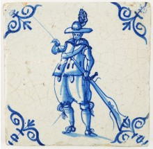 Antique Delft tile with a soldier loading a musket, 17th century