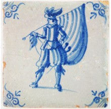 Antique Delft tile with a standard-bearer in blue, 17th century