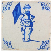 Antique Dutch Delft tile with a standard-bearer in blue, 17th century